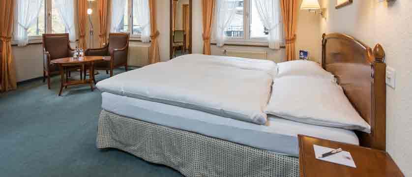 switzerland_saas-fee_hotel-sunstar-beausite_bedroom.jpg